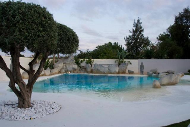 Como hacer piscina de arena de playa o compactada for Precio construir piscina