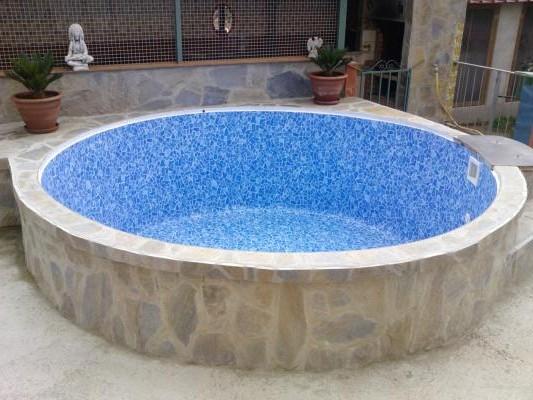 Como hacer piscina de obra elevada for Hacer piscina climatizada en casa